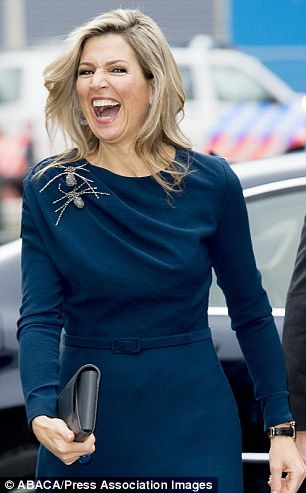 Maxima laughed and smiled as she was greeted by photographers on arrival...