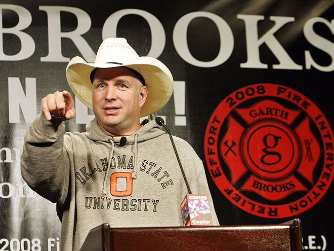 """GARTH BROOKS  The good deed: Saved two boys from an Oklahoma wildfire   He's sung about """"Standing Outside the Fire,"""" but country star Garth Brooks actually went inside the flames of a raging, 600-acre Oklahoma wildfire in 2000 to save two boys and a neighboring family from the oncoming blaze, ferrying them to safety in his pickup truck. One of his evacuees reportedly told the 14- and 10-year-old brothers afterwards, """"You just got saved by Garth Brooks."""""""