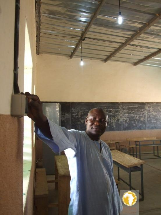 Using the school's light switch for the first time. (Loura, Burkina Faso, West Africa)