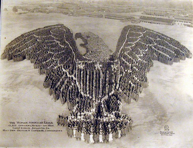 12,500 officers, nurses and soldiers from Camp Gordon form a human eagle. [1918]