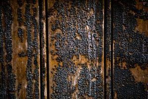 Burnt smells might still exist on wood even after you remove the burnt surface.