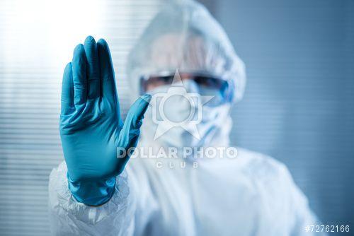 https://pl.dollarphotoclub.com/stock-photo/Female scientist in protective hazmat suit with hand raised/72762166Dollar Photo Club - miliony zdjęć stockowych w cenie 1$ każde