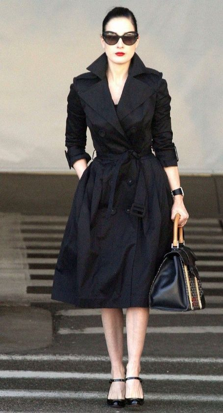 Dita Von Teese looks pretty and polished as she lands at LAX airport on Sunday (October 30) in Los Angeles.