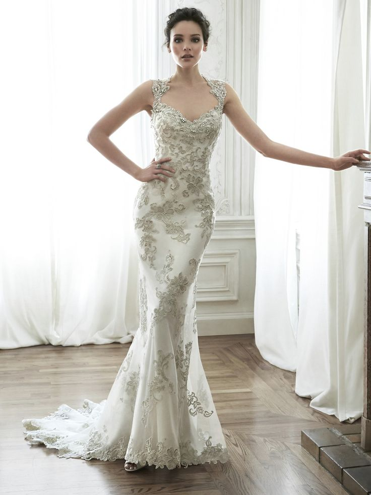 Lovely Maggie Sottero Jade Exquisite bead embroidered lace adorns the bodice in this sheath wedding dress with Swarovski crystal neckline