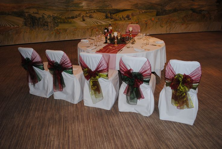 Dark red & green organza sashes on white cotton chair covers at The Vineyard at Stockcross by Simply Bows and Chair Covers