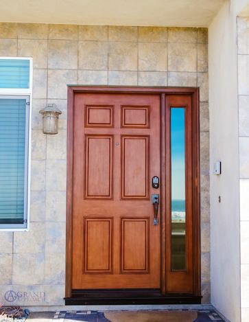 Outdoor wood door protection is a must when you live by the beach!