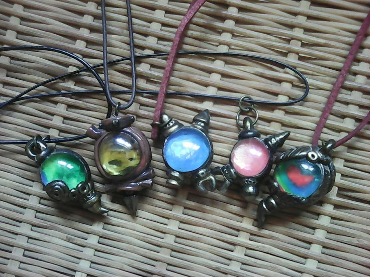 Double faced vessel pendants