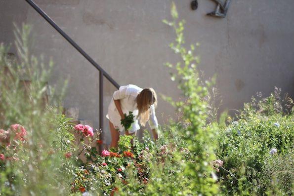"Beautiful Malin Elmlid gathering herbs from her privet garden in ""Kyriakos"" apartment-photo Malin Elmlid"