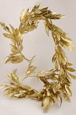 19.99 SALE PRICE! Wrap this golden Bay Leaf Garland around sparkling mercury glass candle holders on your mantel or wedding reception tables. This stunning m...
