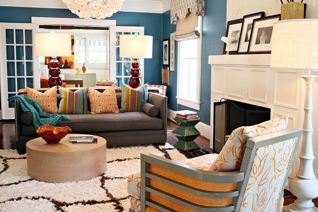 Living room w/ multiple personalities: mid-century modern, traditional, abstract, sharp contrast against white trim, mixed metals & textures... not sure if my ADHD brain can handle the mix