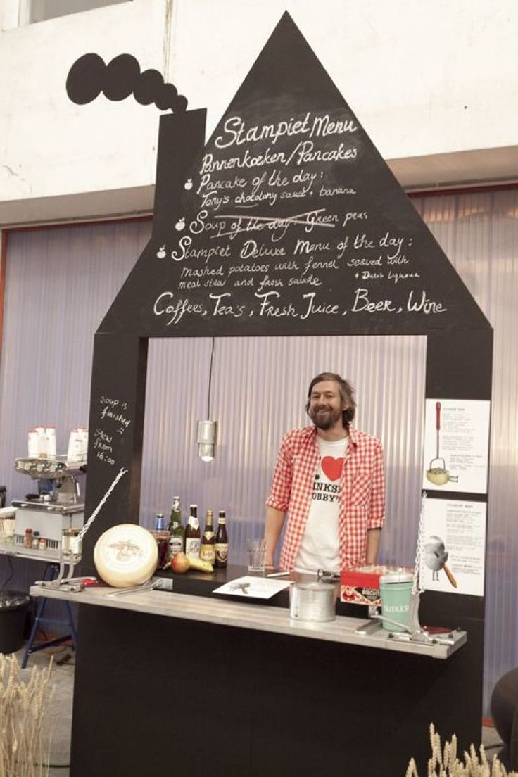 A simple foldable plywood cutout painted with blackboard paint can become the perfect pop up shop