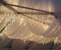 Something similar to this for the draping under the tent