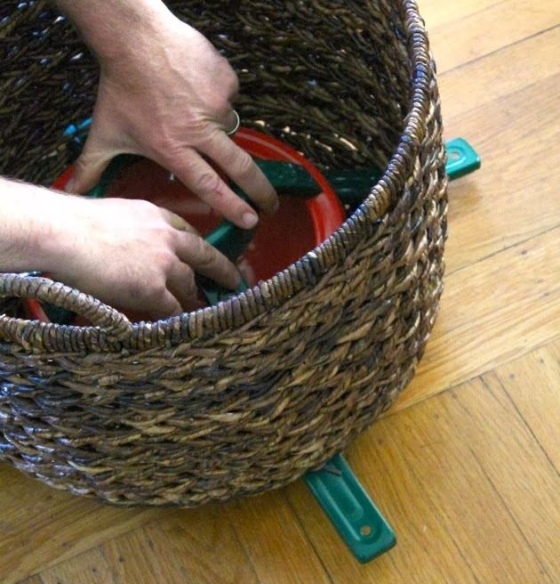 Christmas Tree Basket Stand. Could do this for a fake tree too, many of them don't have branches that go very low.