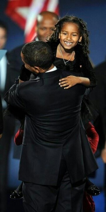 President Barak Obama With Sasha Obama....