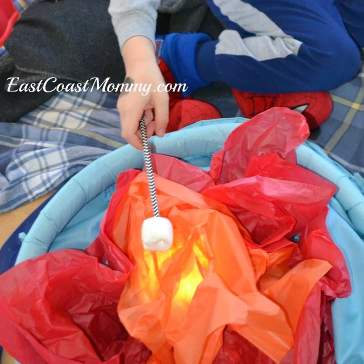 """Such a fun idea for """"pretend play"""" -- a simple indoor campfire that really glows."""