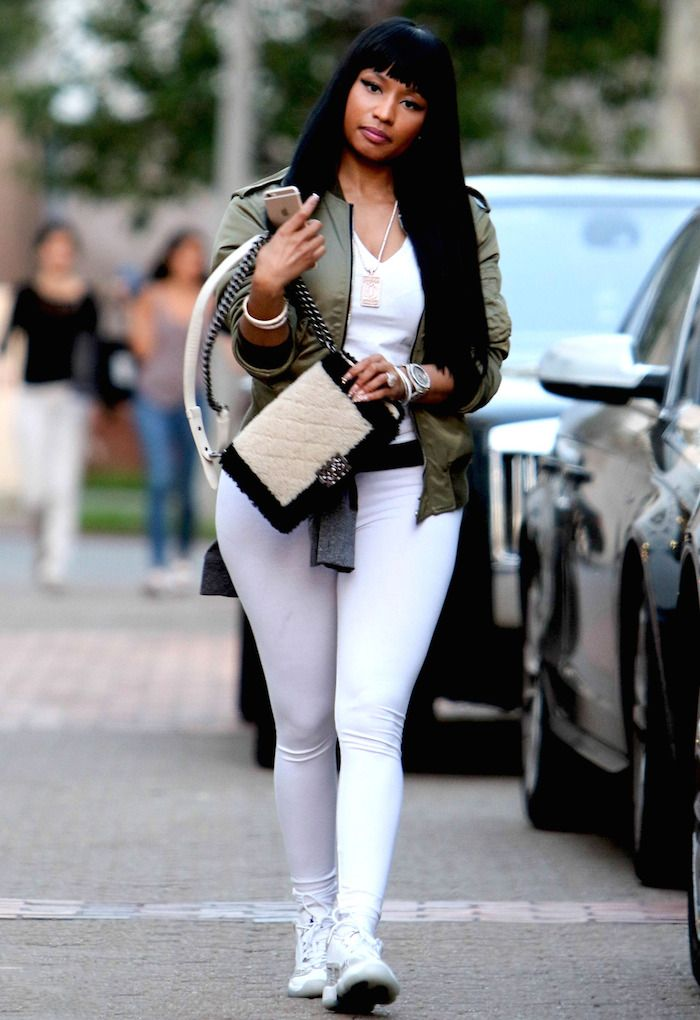 3 Nicki Minaj's Saint Laurent Olive Green Bomber Jacket and Air Jordan Retro Sneakers