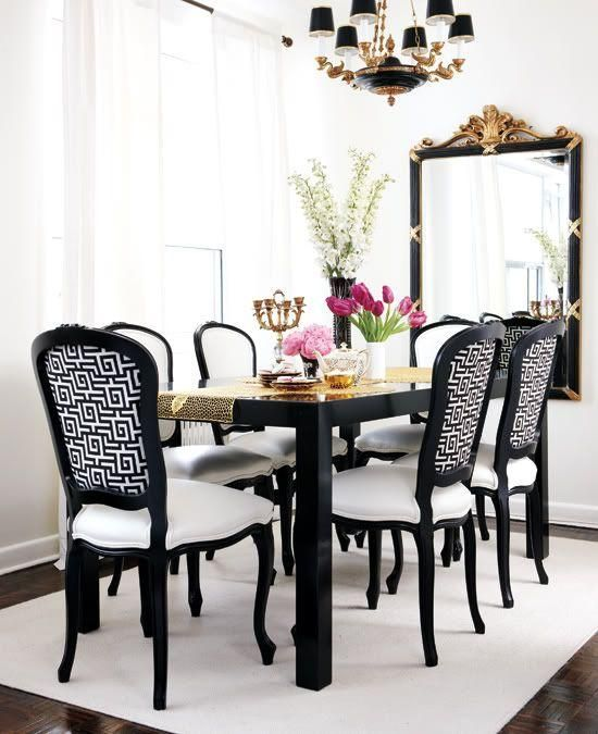 Glamorous Dining Room With Glossy Black Table French Chairs Upholstered In White Greek Key Fabric Leather Cushions