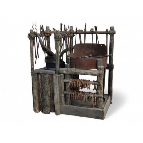 Rustic wooden Blacksmith's forge with tools.