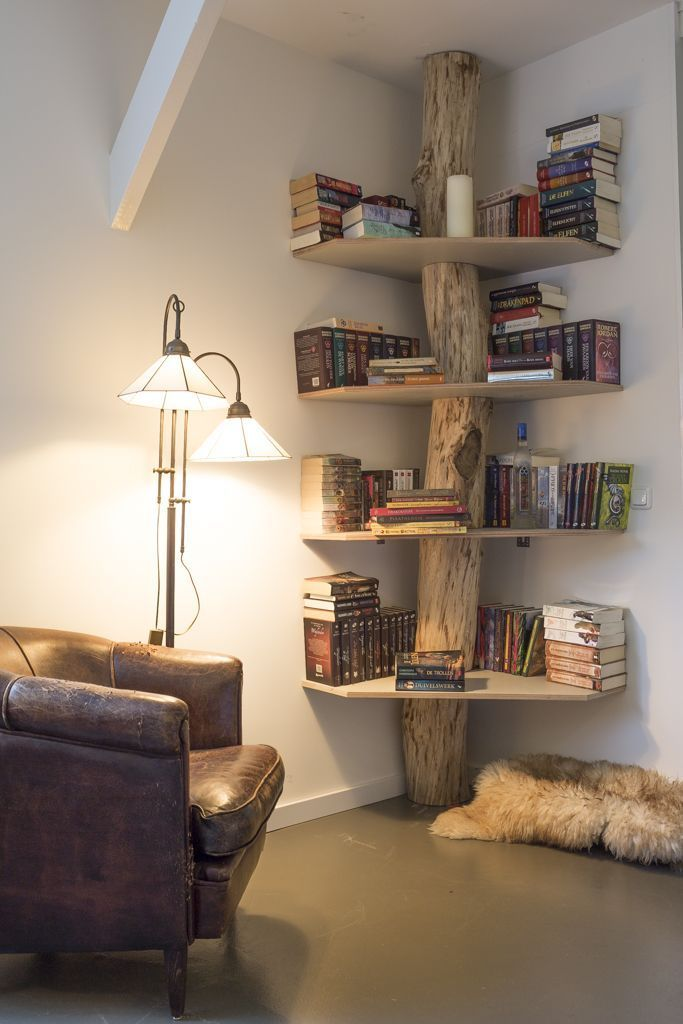 Creative bookshelf made from tree stump. See more creative bookshelf ideas on http://www.thediyhubby.com/10-creative-diy-bookshelf-projects/