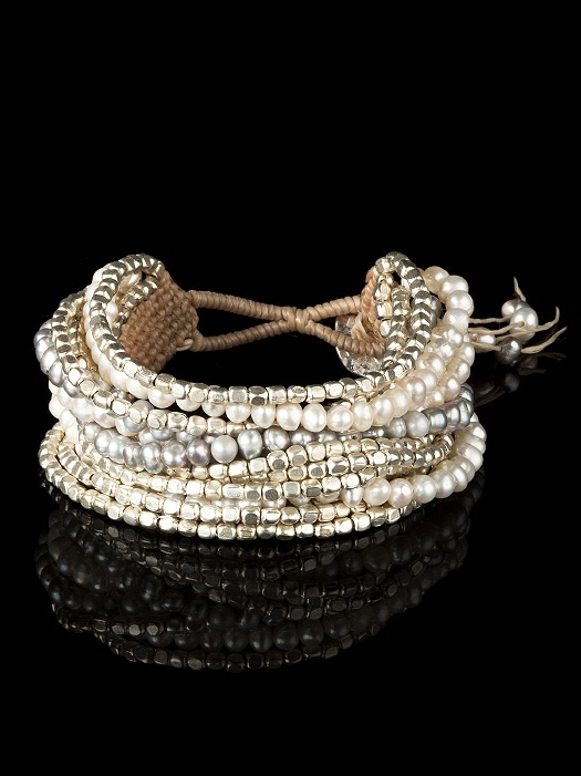 Multi-strand bracelet includes warm silver toned beads, gray pearls and ivory pearls. Adjustable silver button closure. Ships in silver gift box. .$40