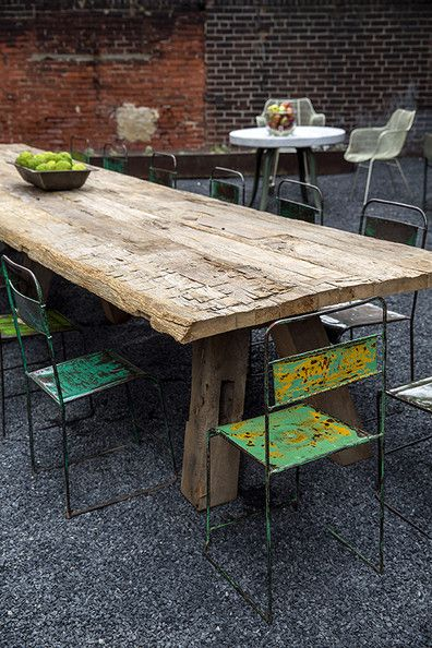Eclectic Decor - An outdoor table and metal chairs at American Street Showroom