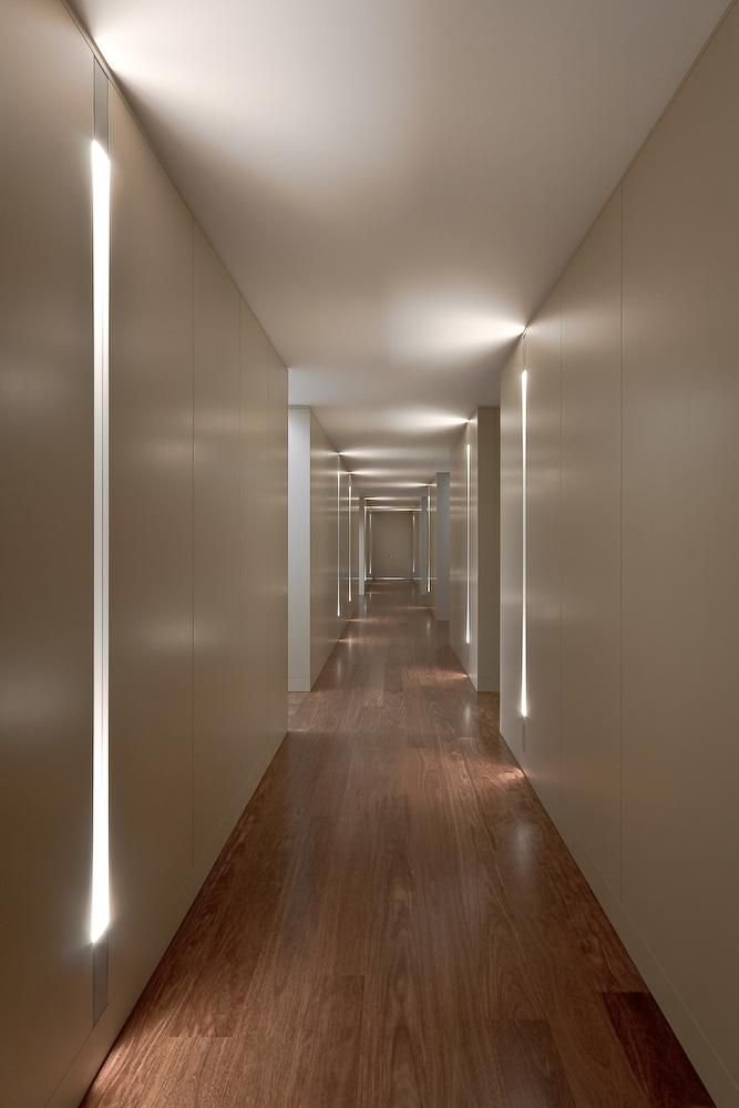 F3 breezeway concept with uplights at the base of the floor tucked into a detail with moments of uplight on the ceiling at bedroom entrances.