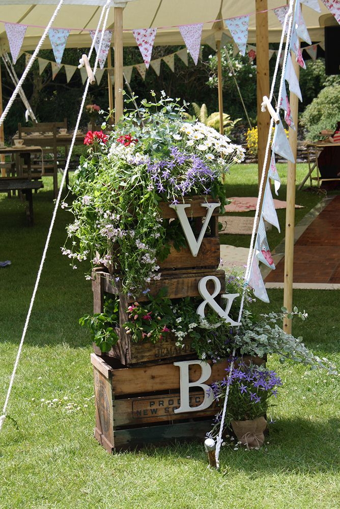 3 Crate flower display (displays vary depandant on flowers in season and positioning of crates) - £65 hire price each (Quantity: 2) Wooden letters - £3 hire price each