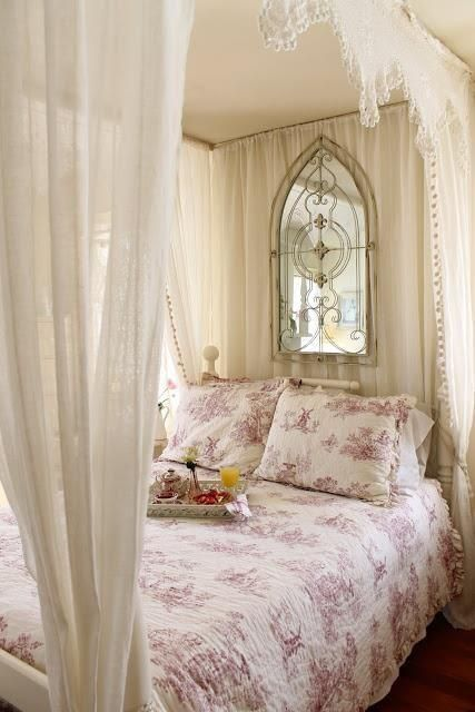 Easy to reproduce... rods hung from ceiling - gauze drapes from World Market at the ends and head - your grandmothers doilies ... I've seen a similar mirror at Hobby Lobby or Wayfair - the bed is a traditional basic