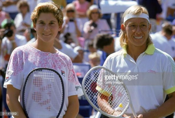 Monica Seles poses with Martina Navratilova after winning the 1991 US Open Championship at USTA National Tennis Center in Flushing Meadows Park on August 26,1991 in New York, New York.