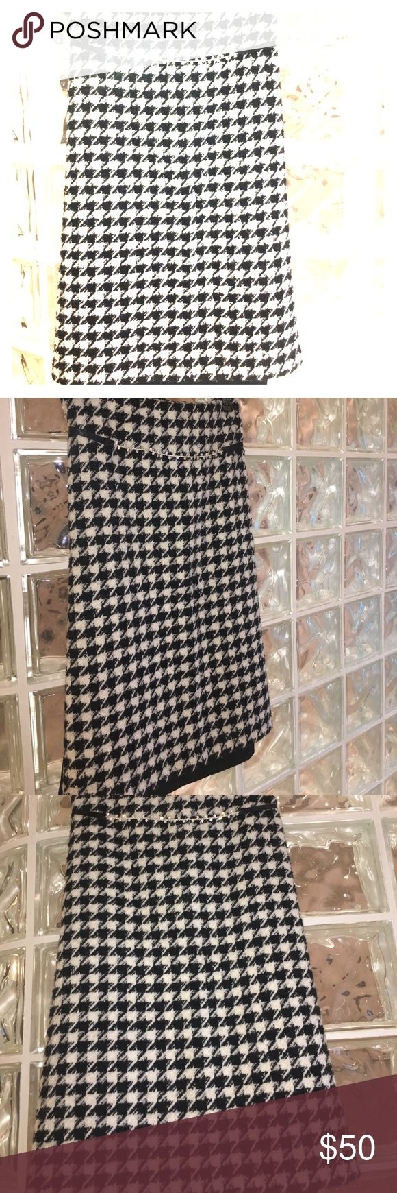 Wool Houndstooth Midi Skirt - NWOT - Eloquii Stay warm and in style with this wool, midi, houndstooth skirt. Houndstooth on the front and Scuba material in black on the back which means your backside is going to look goood!!! Pair with some black ankle booties or talk black boots and you'll scream sophistication without saying a word. Eloquii Skirts Midi