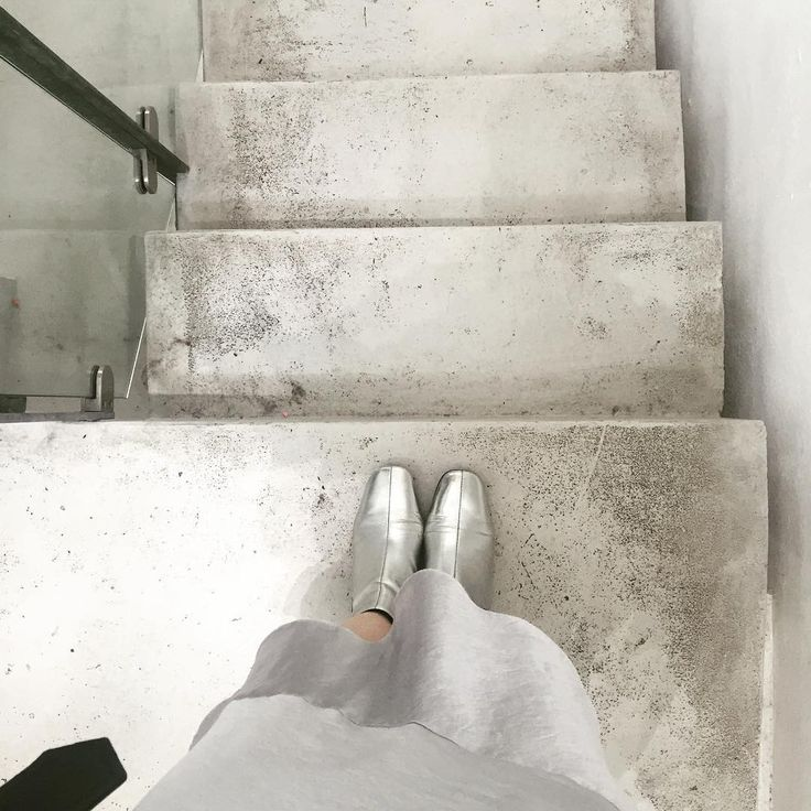 FWIS standing on a concrete floor at LFW with River Island silver boots and topshop silver slip.