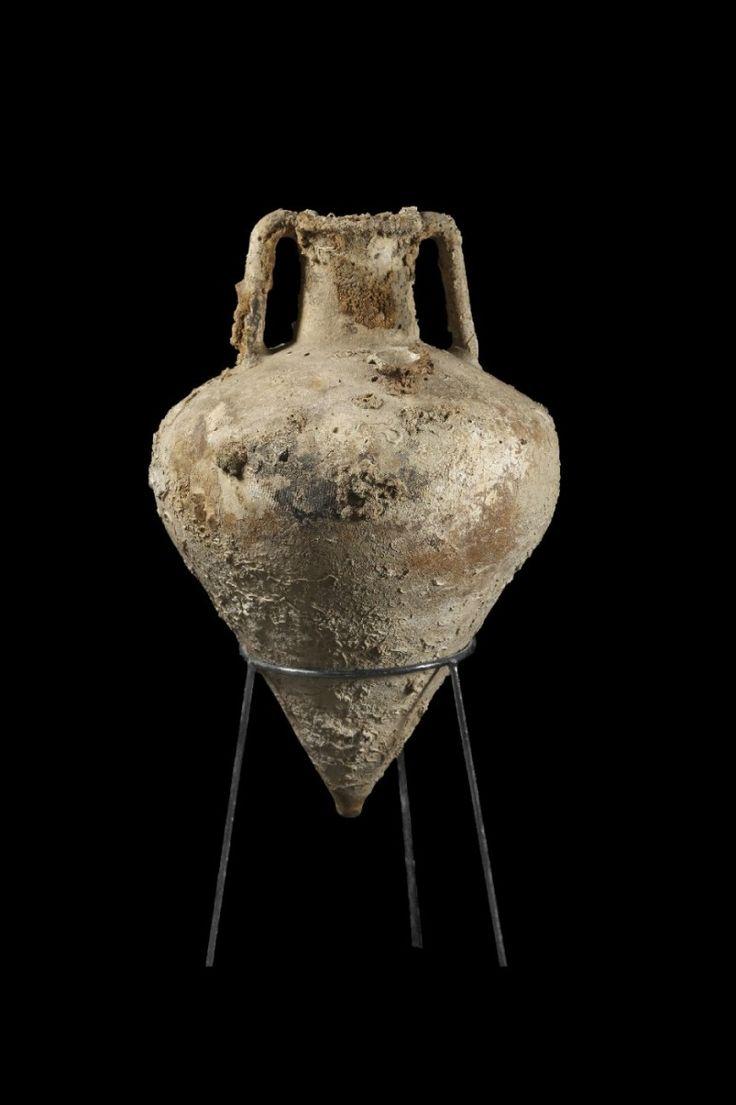 Corinthian amphora, 6th-2nd century B.C.  Transportamphora for wine, Corinthian B., sea incrustations, 61.5 cm high. Private collection