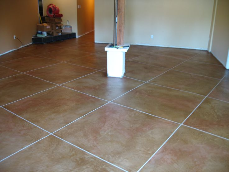 Tile design flooring using soycrete concrete stain with sawcuts to create grout line effects - Decoratie grot ...