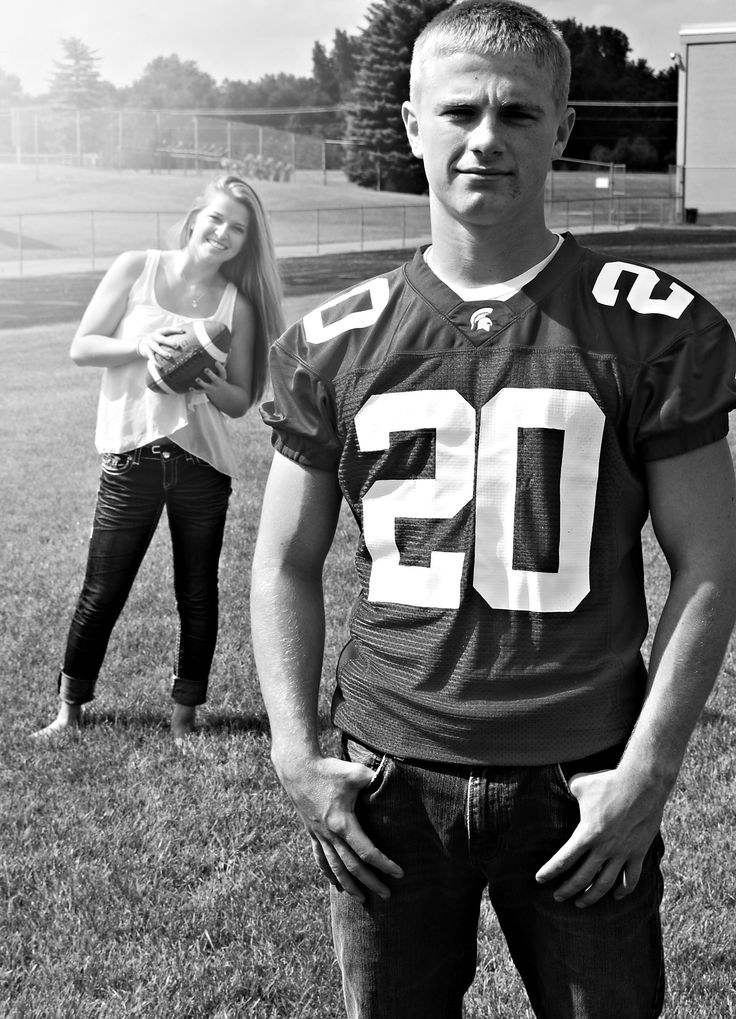Senior photo idea. Girfriend, sister, mom in the background of a senior football player.