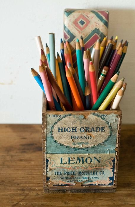 Colored pencils in a vintage wooden crate.