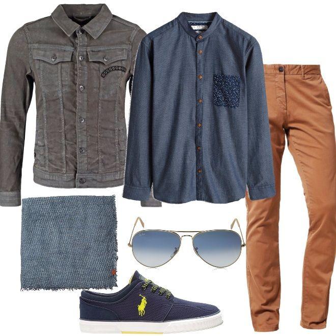 Giacca e camicia di jeans fanno da padrona in questo look, abbinate ad un pantalone a sigaretta color cammello, sneakers blu con lacci e suola giallo fluo. Concludono un outfit decisamente casual, una sciarpa per proteggerci dall'umidità e degli occhiali Ray-Ban, adatto a diverse occasioni, grazie alla scelta accurata dei capi.