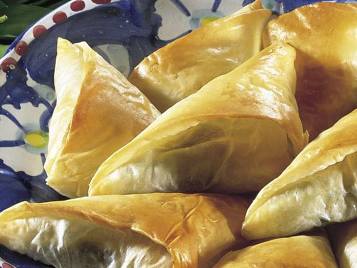 These tasty little Greek-style cheese and spinach filo triangles are delicious served with a squeeze of fresh lemon. Great as finger food or for an after-school snack.