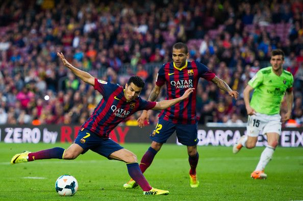 Pedro Rodriguez (L) of FC Barcelona scores his team's seventh goal during the La Liga match between FC Barcelona and CA Osasuna at Camp Nou on March 16, 2014 in Barcelona, Catalonia.