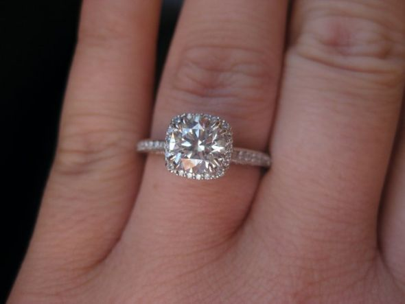 This is listed as a round stone (ideal cut- sparkliest!) in a super thin cushion halo (yay!) with a thin micropave band. This center stone is 1.31 ctw. I think it would look perfect in one carat :) Found on Weddingbee.com Share your inspiration today!