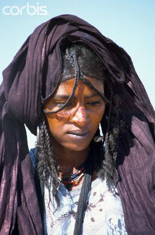 Africa | Tuareg woman with painted face at the annual Islamic Mouloud celebrations.   I-n-Gall, Agadez Region, Niger | © Tiziana and Gianni Baldizzone