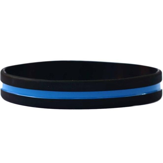 The Thin Blue Line Silicone Bracelet commemorates fallen officers and symbolizes the relationship of law enforcement in the community as the protectors of civil