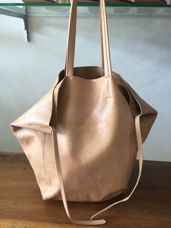 Check out this item in my Etsy shop https://www.etsy.com/listing/265649549/leather-tote-slouch-bag-tan-handbag