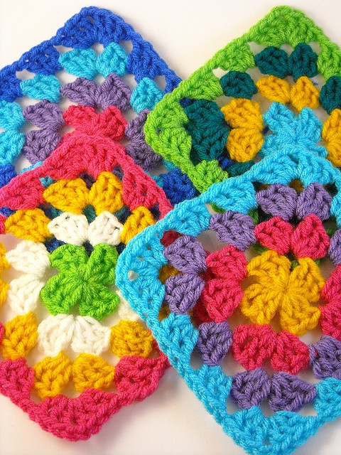 Granny squares. These are soooo pretty! I can only hope the ones I'm currently working on are 1/2 pretty when I'm finished!