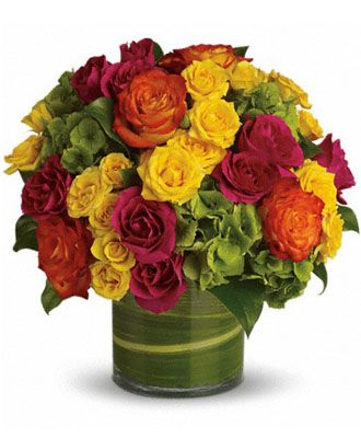 Blow someone away with a #bouquet that has so much style? all it needs is its own runway. Brilliant green #hydrangea, hot pink and bi-color #roses, hot pink and yellow spray #roses and greens are hand-delivered in stunning style: a wide cylinder #vase that's been elegantly lined with leaves. This #bouquet is a singular sensation!