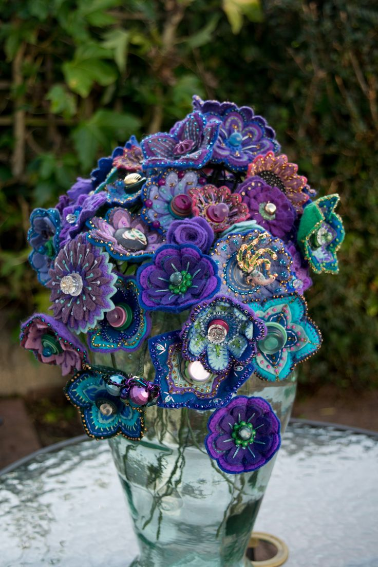 Flowers, felt, embroidered with beads and vintage buttons. Made by Kate Clark for Moira's wedding bouquet.