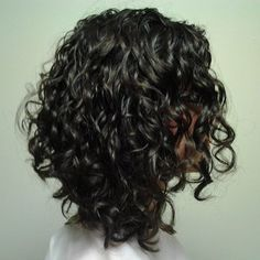 A-Line design with Curly Hair is cut one curl at a time on dry hair. | Yelp