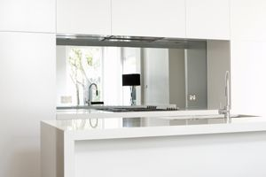 Mirrored kitchen splash back.  Great for creating the illusion of space and light.