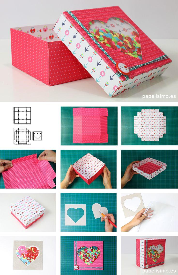 """Las cajas de regalo shaker (del ingléssalero) son cajas que tienen una """"ventana"""" con pequeñas piezas dentro que se mueven al agitar la caja. Son un modelo de caja muy popular en el mundo scrapbooking y pueden rellenarse de lentejuelas, purpurina, confeti, cuentas de bisutería… cualquier cosa que se pueda mover en su interior. Ojo, la caja no está rellena, dentro va el regalo, donde van las piezas pequeñas es enventana de plástico. ¿Quieres aprender a hacerlas? ¿Qué necesito para hacer…"""