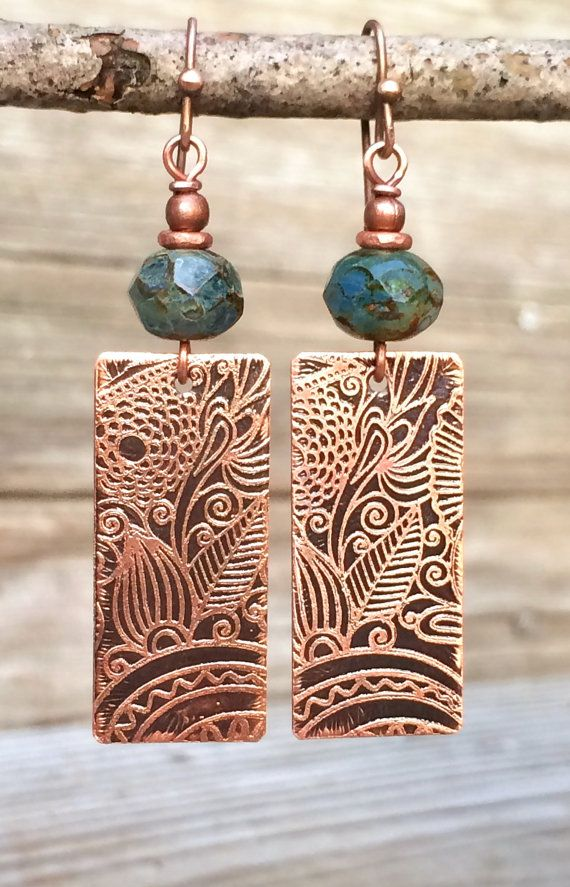 Beautiful hand etched copper earrings with blue Czech glass. Hand etched floral patterned copper with a beautiful blue/green Czech glass bead. Very light weight, approx 2 in length. You may also like: https://www.etsy.com/listing/166392591/copper-earrings-autumn-earrings-copper?ref=shop_home_active_9