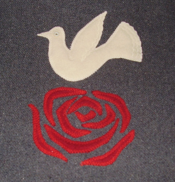 Dove & rose cushion cover. Made from old woolen blankets.
